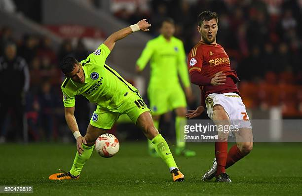 Gary Gardner of Nottingham Forest makes a challenge on Tomer Hemed of Brighton and Hove Albion during Sky Bet Championshipon match between Nottingham...