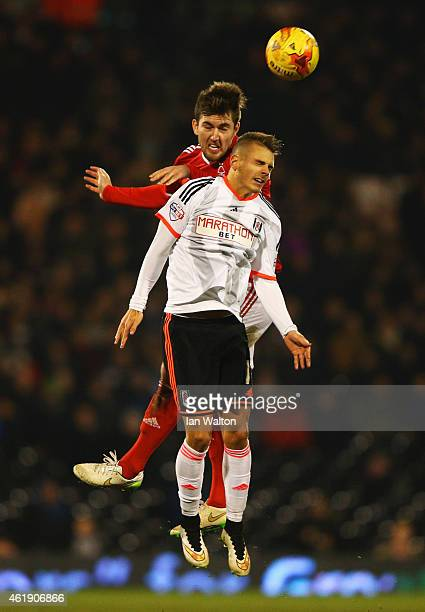Gary Gardner of Nottingham Forest outjumps Alex Kacaniklic of Fulham during the Sky Bet Championship match between Fulham and Nottingham Forest at...