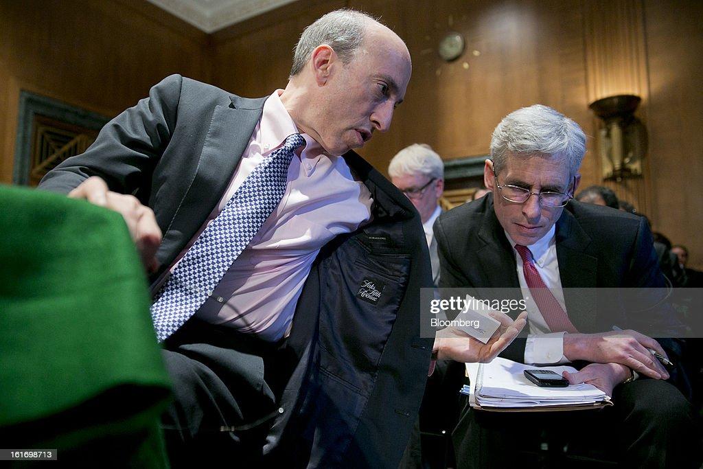 Gary Gensler, chairman of the U.S. Commodity Futures Trading Commission (CFTC), left, speaks to an assistant during a Senate Banking Committee hearing in Washington, D.C., U.S., on Thursday, Feb. 14, 2013. U.S. regulators told lawmakers they are making significant progress to prevent a repeat of the 2008 credit crisis, pushing back against complaints of slow progress and efforts to undo parts of the Dodd-Frank Act. Photographer: Andrew Harrer/Bloomberg via Getty Images