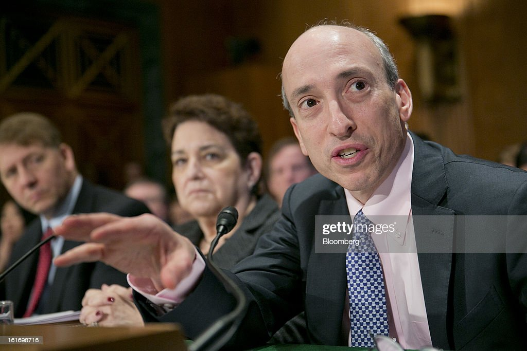 Gary Gensler, chairman of the U.S. Commodity Futures Trading Commission (CFTC), right, speaks during a Senate Banking Committee hearing while Elisse Walter, chairman of the Securities and Exchange Commission (SEC), and Richard Cordray, director of the Consumer Financial Protection Bureau (CFPB) listen in Washington, D.C., U.S., on Thursday, Feb. 14, 2013. U.S. regulators told lawmakers they are making significant progress to prevent a repeat of the 2008 credit crisis, pushing back against complaints of slow progress and efforts to undo parts of the Dodd-Frank Act. Photographer: Andrew Harrer/Bloomberg via Getty Images
