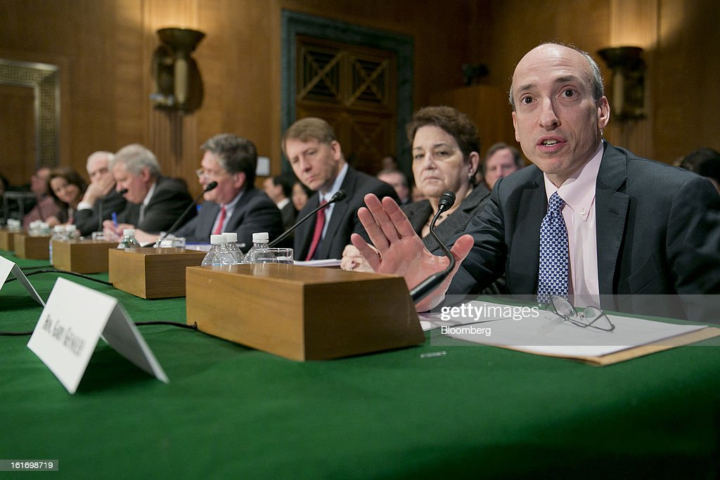 Gary Gensler, chairman of the U.S. Commodity Futures Trading Commission (CFTC), right to left, Elisse Walter, chairman of the Securities and Exchange Commission (SEC), Richard Cordray, director of the Consumer Financial Protection Bureau (CFPB), Thomas Curry, comptroller of the U.S. currency, Martin Gruenberg, chairman of the Federal Deposit Insurance Corp. (FDIC), Daniel Tarullo, governor of the U.S. Federal Reserve, and Mary Miller, undersecretary for domestic finance at the U.S. Treasury, testify during a Senate Banking Committee hearing in Washington, D.C., U.S., on Thursday, Feb. 14, 2013. U.S. regulators told lawmakers they are making significant progress to prevent a repeat of the 2008 credit crisis, pushing back against complaints of slow progress and efforts to undo parts of the Dodd-Frank Act. Photographer: Andrew Harrer/Bloomberg via Getty Images
