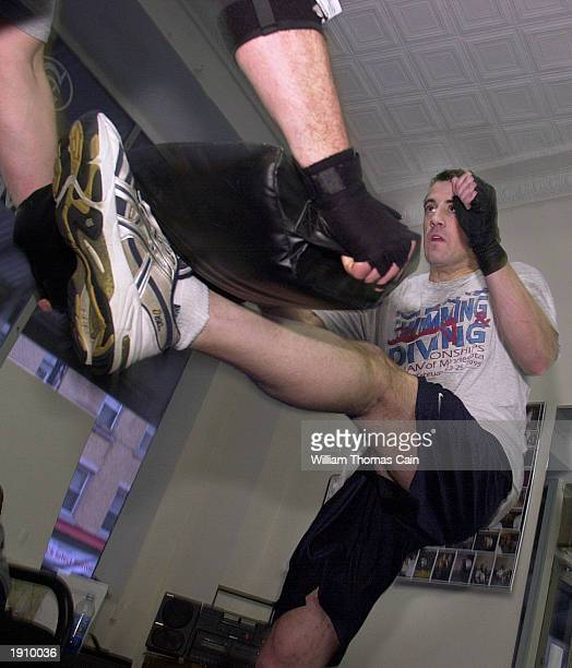 Gary Goldenberg holds a tombstone pad catching the foot of Rob Watterson in a Krav Maga class April 9 2003 in Philadelphia Pennsylvania With the US...