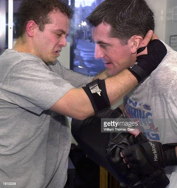 Gary Goldenberg practices a move with Rob Watterson in a Krav Maga class April 9 2003 in Philadelphia Pennsylvania With the US at high terror alert...