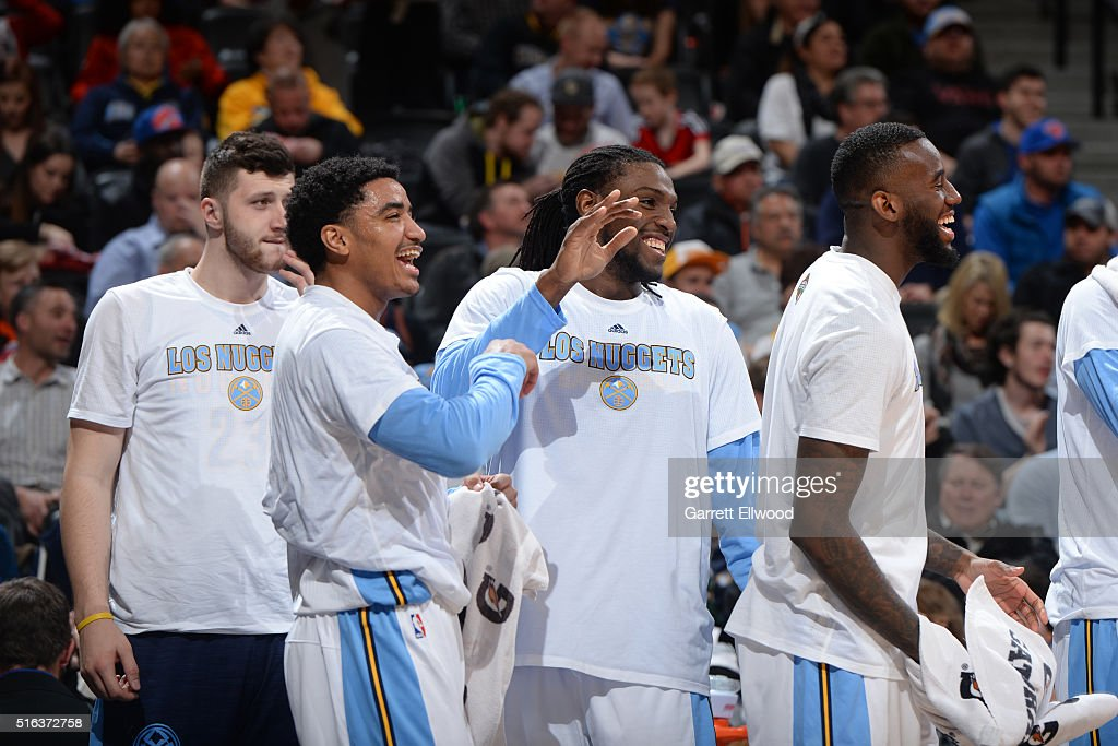 Gary Harris #14 and Kenneth Faried #35 of the Denver Nuggets share a laugh during the game against the New York Knicks on March 8, 2016 at the Pepsi Center in Denver, Colorado.