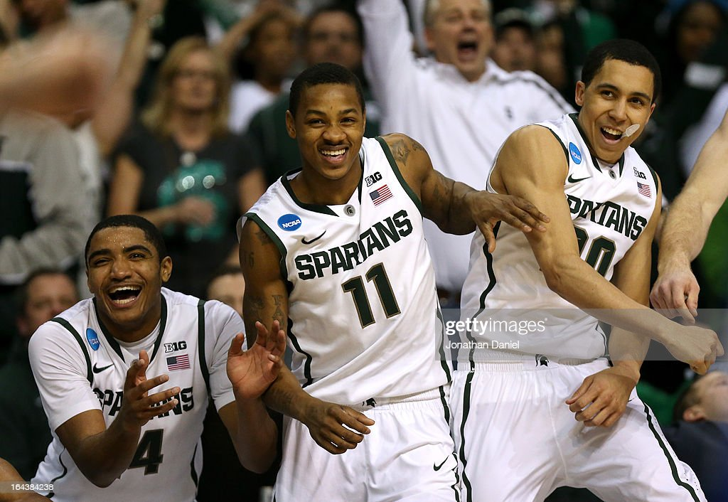 Gary Harris #14, Keith Appling #11 and Travis Trice #20 of the Michigan State Spartans celebrate on the bench against the Memphis Tigers during the third round of the 2013 NCAA Men's Basketball Tournament at The Palace of Auburn Hills on March 23, 2013 in Auburn Hills, Michigan.