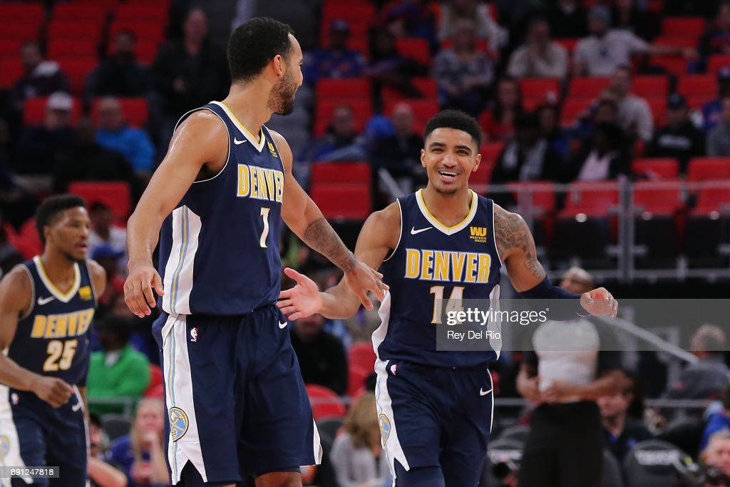 Gary Harris #14 of the Denver Nuggets celebrates with his teammate Trey Lyles #7 of the Denver Nuggets during the game against the Detroit Pistons at Little Caesars Arena on December 12, 2017 in Detroit, Michigan.