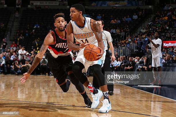 Gary Harris of the Denver Nuggets controls the ball against Allen Crabbe of the Portland Trail Blazers at Pepsi Center on November 9 2015 in Denver...