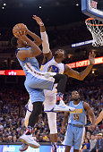 Gary Harris of the Denver Nuggets goes up to shoot and has his shot contested by Jason Thompson of the Golden State Warriors during thier NBA...