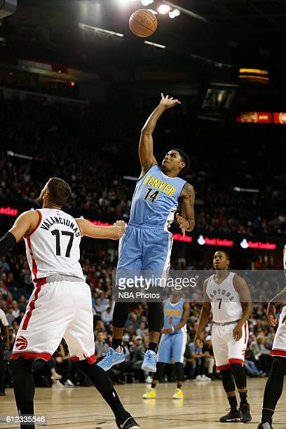 Gary Harris of the Denver Nuggets shoots the ball against the Toronto Raptors on October 3 2016 at the Scotiabank Saddledome in Calagary Alberta...