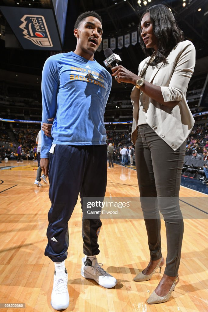Gary Harris #14 of the Denver Nuggets talks with former WNBA player Lisa Leslie after the game against the Los Angeles Lakers on March 13, 2017 at the Pepsi Center in Denver, Colorado.