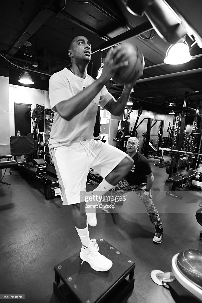 Gary Harris #14 of the Denver Nuggets works out with Steve Hess before the game against the Utah Jazz on January 24, 2017 at the Pepsi Center in Denver, Colorado.