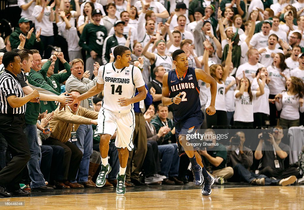 Gary Harris #14 of the Michigan State Spartans celebrates a second half three point basket with a fan in front of Joseph Bertrand #2 of the Illinois Fighting Illini at the Jack T. Breslin Student Events Center on January 31, 2013 in East Lansing, Michigan. Michigan State won the game 80-75.