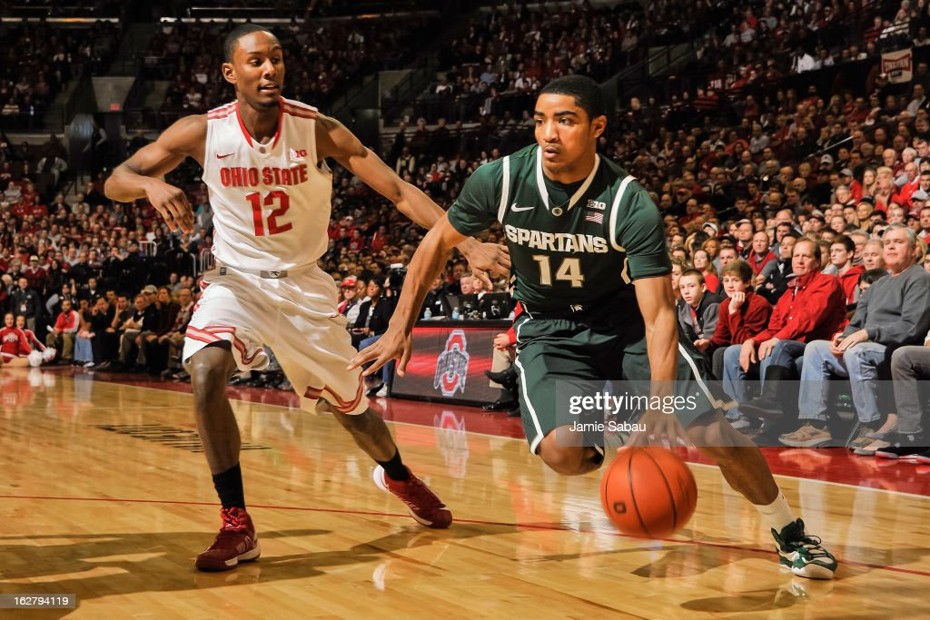 Gary Harris #14 of the Michigan State Spartans dribbles around Sam Thompson #12 of the Ohio State Buckeyes on February 24, 2013 at Value City Arena in Columbus, Ohio.