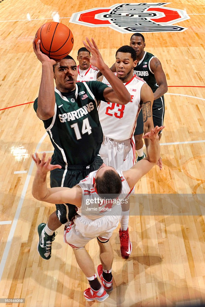 Gary Harris #14 of the Michigan State Spartans drives to the basket for two points as he his fouled by <a gi-track='captionPersonalityLinkClicked' href=/galleries/search?phrase=Aaron+Craft&family=editorial&specificpeople=7348782 ng-click='$event.stopPropagation()'>Aaron Craft</a> #4 of the Ohio State Buckeyes in the first half on February 24, 2013 at Value City Arena in Columbus, Ohio.