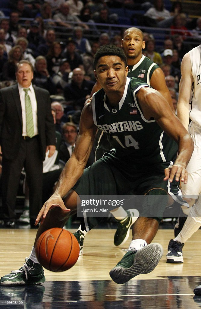 Gary Harris #14 of the Michigan State Spartans drives to the hoop against the Penn State Nittany Lions at the Bryce Jordan Center on December 31, 2013 in State College, Pennsylvania.