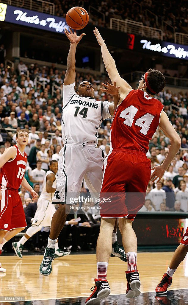 Gary Harris #14 of the Michigan State Spartans gets a second half shot off over Frank Kaminsky #44 of the Wisconsin Badgers at the Jack T. Breslin Student Events Center on March 7, 2013 in East Lansing, Michigan. Michigan State won the game 58-43.