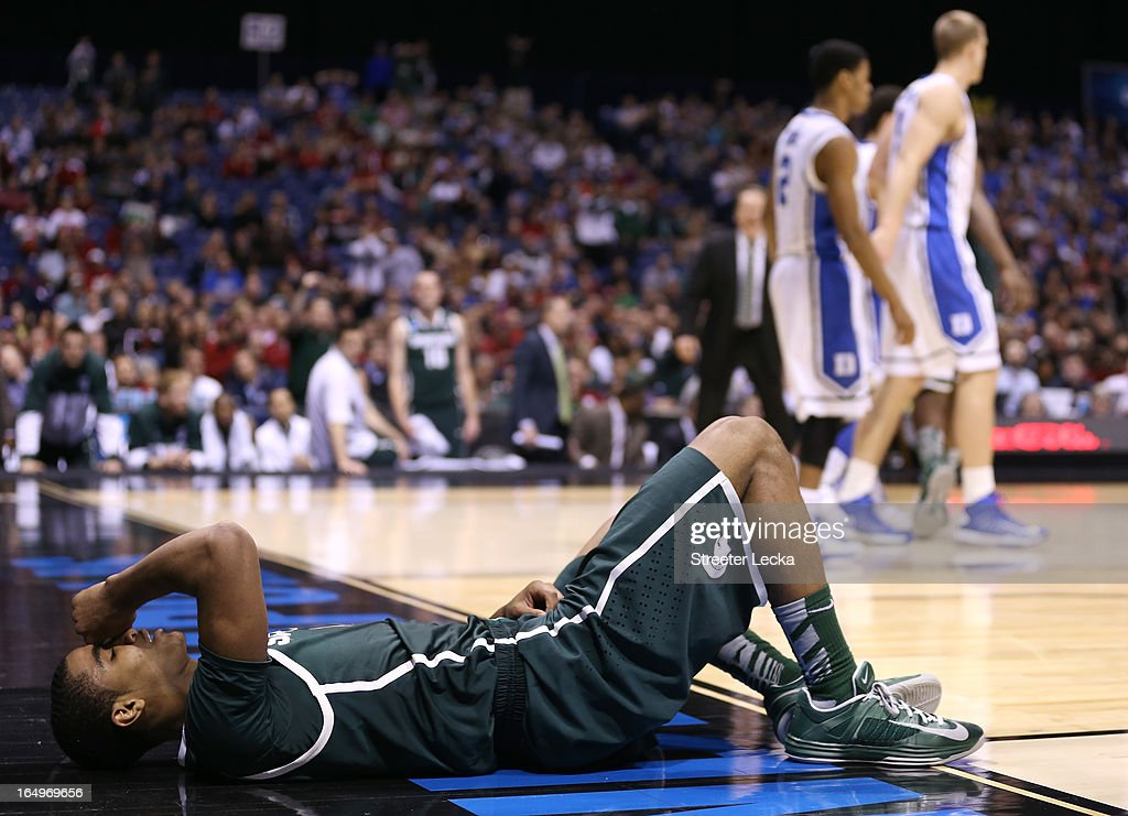 Gary Harris #14 of the Michigan State Spartans lies on the court in pain after he was fouled in the second half by Seth Curry #30 of the Duke Blue Devils during the Midwest Region Semifinal round of the 2013 NCAA Men's Basketball Tournament at Lucas Oil Stadium on March 29, 2013 in Indianapolis, Indiana.