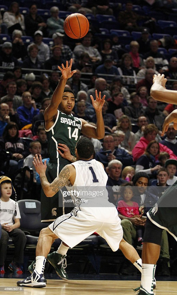 Gary Harris #14 of the Michigan State Spartans passes the ball against the Penn State Nittany Lions at the Bryce Jordan Center on December 31, 2013 in State College, Pennsylvania.