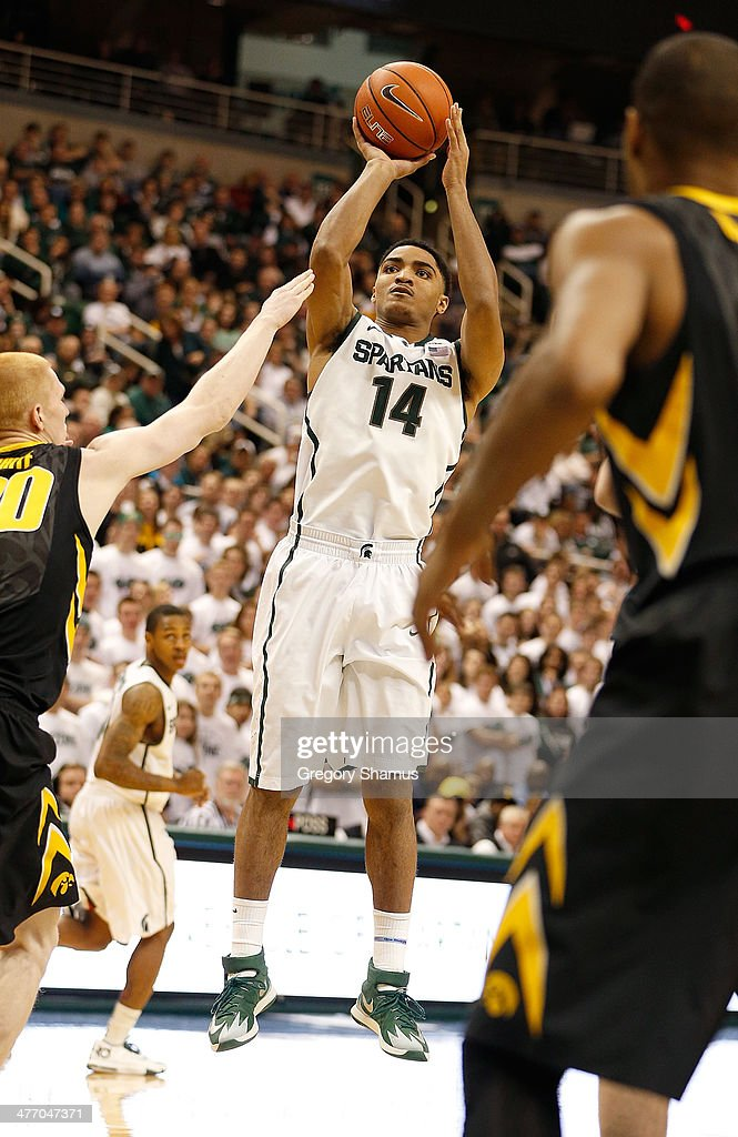 Gary Harris #14 of the Michigan State Spartans takes a second half jump shot while playing the Iowa Hawkeyes at the Jack T. Breslin Student Events Center on February 6, 2014 in East Lansing, Michigan. Michigan State won the game 86-76.
