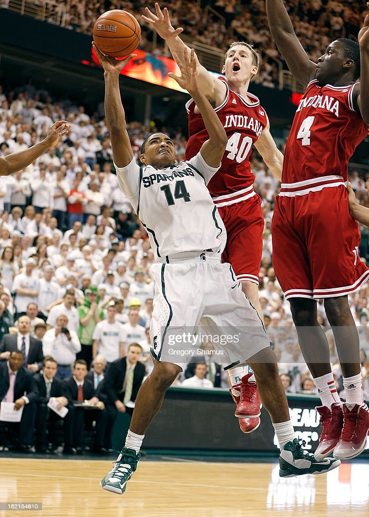 Gary Harris #14 of the Michigan State Spartans tries to get a late second half shot off in front of <a gi-track='captionPersonalityLinkClicked' href=/galleries/search?phrase=Cody+Zeller&family=editorial&specificpeople=7621233 ng-click='$event.stopPropagation()'>Cody Zeller</a> #40 of the Indiana Hoosiers at the Jack T. Breslin Student Events Center on February 19, 2013 in East Lansing, Michigan. Indiana won the game 72-68.