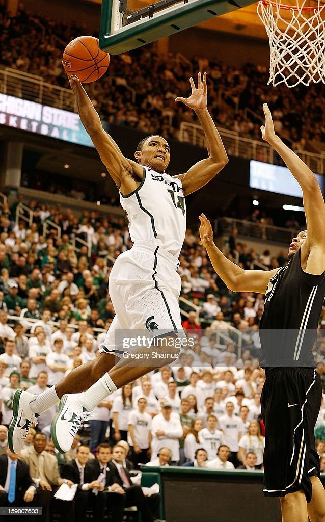 Gary Harris #14 of the Michigan State Spartans tries to get to the basket past A.J. Hammons #20 of the Purdue Boilermakers during the second half at the Jack T. Breslin Student Events Center on January 5, 2013 in East Lansing, Michigan. Michigan State won the game 84-61.