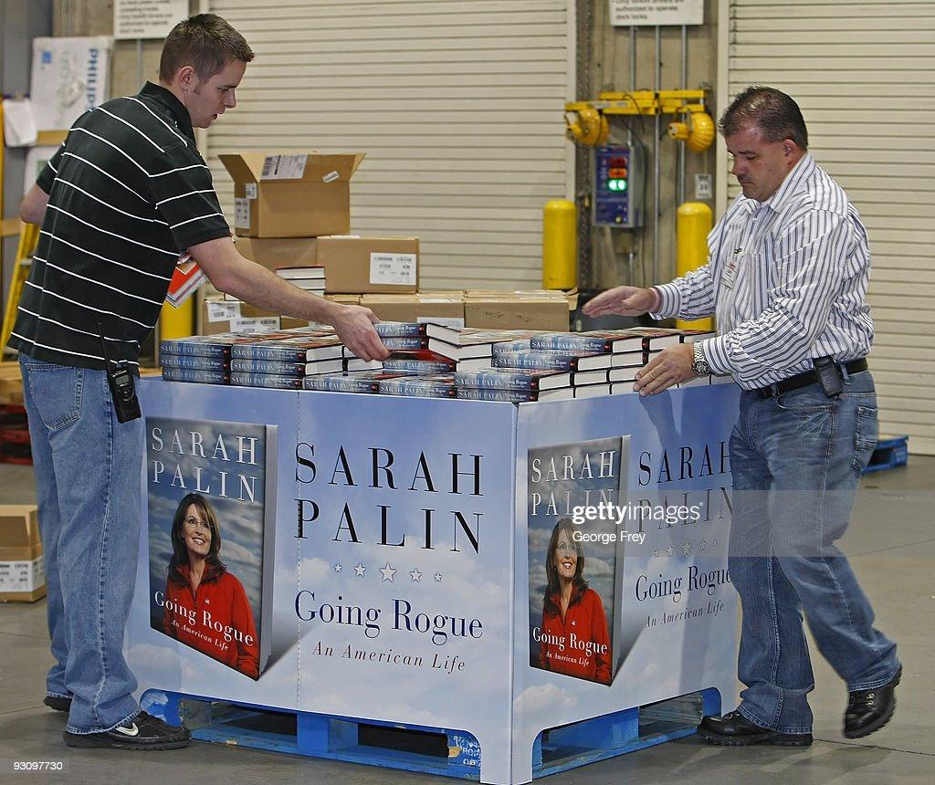 retailers prepare for release of sarah palin s memoir photos and gary haynes r and matt cross l put copies of sarah palin s