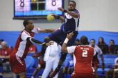 Gary Hines of USA and Alexander de Leon of Dominican Republic in a Men's handball match during the 2011 XVI Pan American Games at San Rafael Gym on...