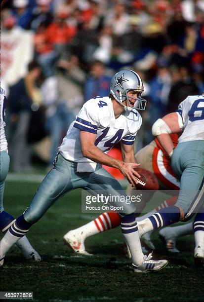 Gary Hogeboom of the Dallas Cowboys turns to hand the ball to a running back against the San Francisco 49ers during an NFL football game December 22...