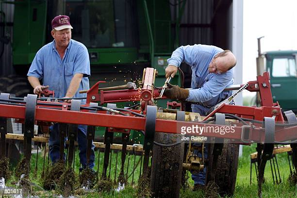 Gary Hohlke left and Sammy Badgett work on welding a field cultivator April 13 2001 in Crawford Texas Crawford the hometown of US President George W...