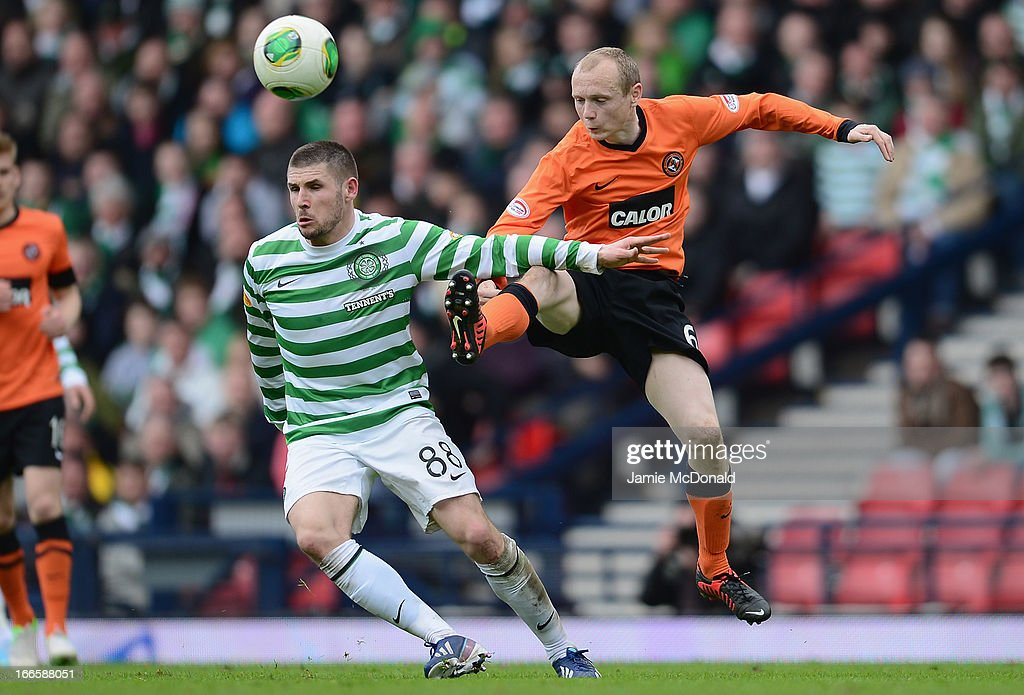 Gary Hooper of Celtic battles with Willo Flood of Dundee United during The William Hill Scottish Cup Semi Final between Dundee United and Celtic at Hampden Park on April 14, 2013 in Glasgow, United Kingdom.