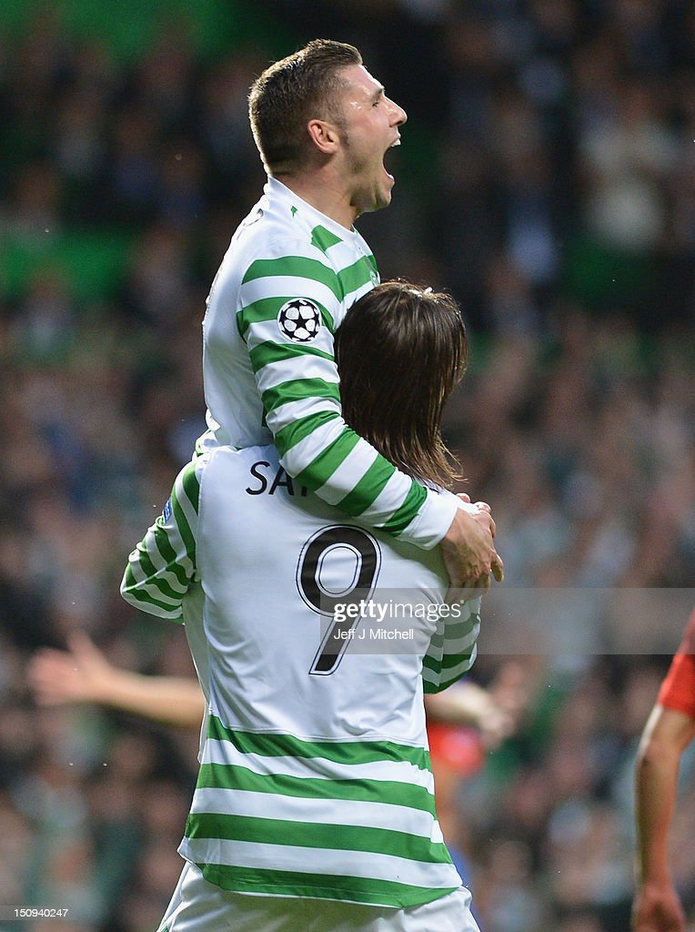 Gary Hooper of Celtic celebrate with Giorgios Samaras after scoring during the UEFA Champions League Play Off Round between Celtic and Helsingborgs IF at Celtic Park on August 29, 2012 in Glasgow, Scotland.