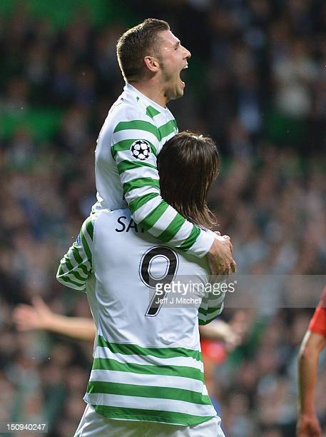 Gary Hooper of Celtic celebrate with Giorgios Samaras after scoring during the UEFA Champions League Play Off Round between Celtic and Helsingborgs...