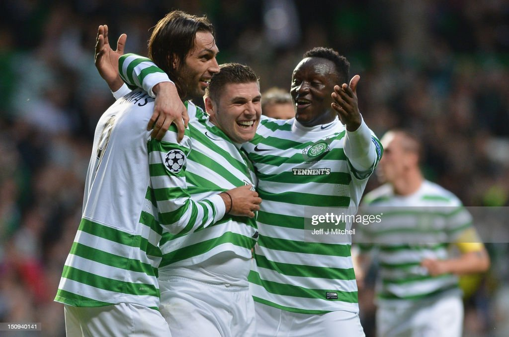 Gary Hooper of Celtic celebrates with Giorgios Samaras and Victor Wanyama after scoring during the UEFA Champions League Play Off Round between Celtic and Helsingborgs IF, at Celtic Park on August 29, 2012 in Glasgow, Scotland.