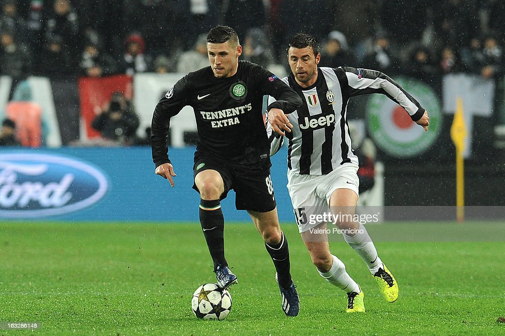 Gary Hooper (L) of Celtic in action against Andrea Barzagli (L) of Juventus during the UEFA Champions League round of 16 second leg match between Juventus and Celtic at Juventus Arena on March 6, 2013 in Turin, Italy.