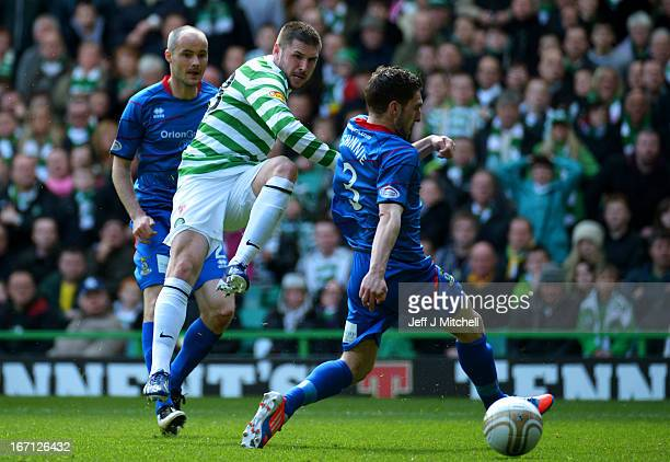 Gary Hooper of Celtic scores the opening goal past Graeme Shinnie of Inverness Caledonian Thistle during the Clydesdale Bank Scottish Premier League...
