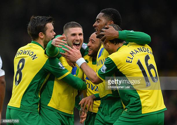 Gary Hooper of Norwich celebrates scoring their first goal with team mates during the Barclays Premier League match between Norwich City and Swansea...