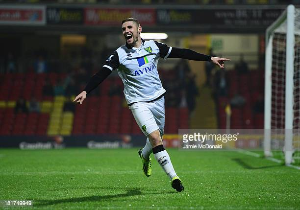 Gary Hooper of Norwich City celebrates as he scores their third goal during the Capital One Cup Third Round match between Watford and Norwich City at...