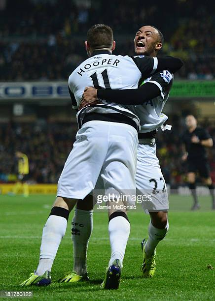 Gary Hooper of Norwich City celebrates with Nathan Redmond as he scores their third goal during the Capital One Cup Third Round match between Watford...
