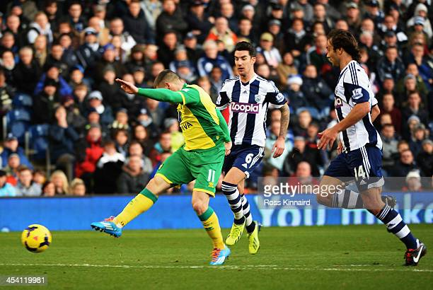 Gary Hooper of Norwich shoots and scores during the Barclays Premier League match between West Bromwich Albion and Norwich City at The Hawthorns on...