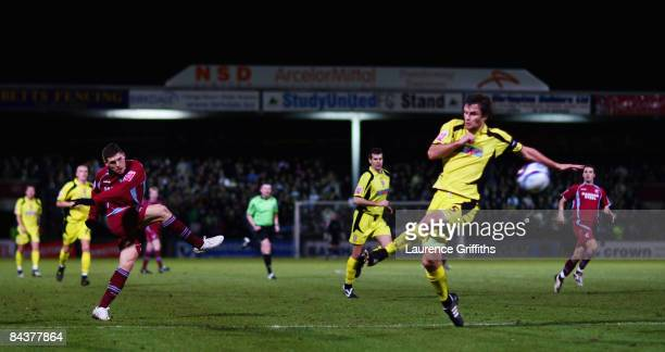 Gary Hooper of Scunthorpe fires a shot at goal during the Johnstone's Paint Trophy Northern Section Final First Leg match between Scunthorpe United...