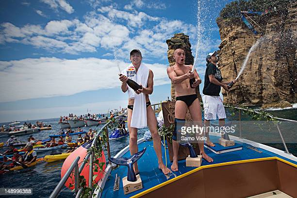 Gary Hunt of Great Britain Artem Silchenko of Russia and Orlando Duque of Colombia celebrate during the third stop of the Red Bull Cliff Diving World...