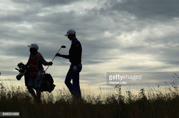 Gary Hurley of Ireland hands his club to his caddie as he walks off the 12th tee during the first round of the Made in Denmark at Himmerland Golf Spa...