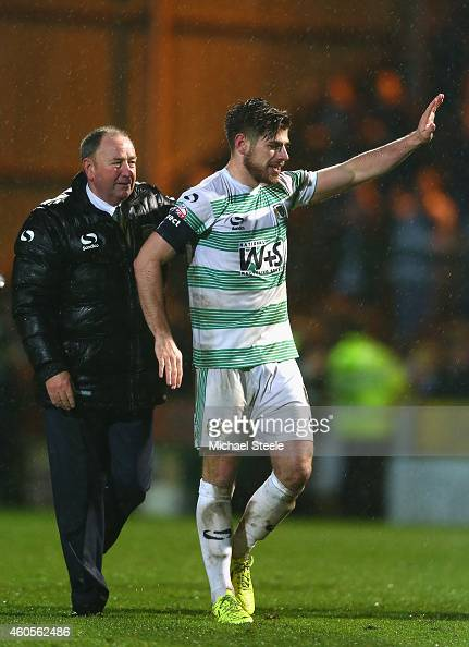 Gary Johnson the manager of Yeovil alongside captain Joseph Edwards after their sides 20 victory during the FA Cup Second Round Replay match between...