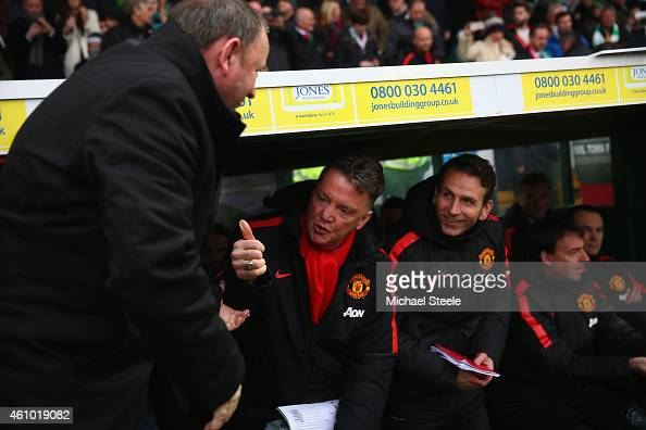 Gary Johnson the manager of Yeovil Town greets Lois Van Gaal the manager of Manchester United prior to kick off during the FA Cup Third Round match...