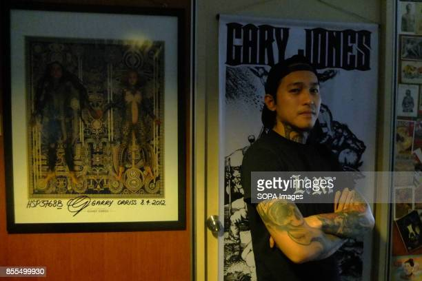 Gary Jones is pictured while posing inside his shop Gary Jones is one of the Kadazan talented tattoo artist from Borneo He had almost 10 years...