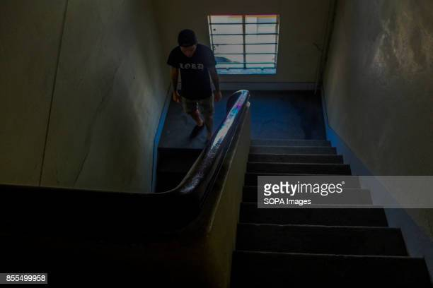 Gary Jones leaves from his tattoo studio after finishing his daily job Gary Jones is one of the Kadazan talented tattoo artist from Borneo He had...