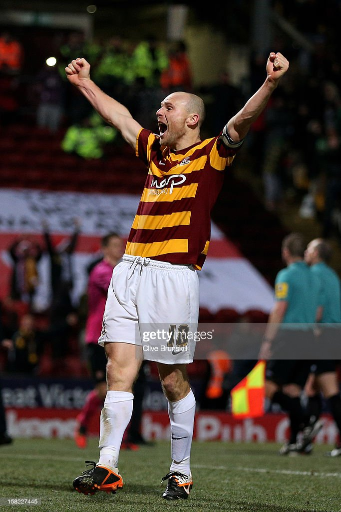 Gary Jones of Bradford celebrates following his team's victory in the penalty shootout during the Capital One Cup quarter final match between Bradford City and Arsenal at the Coral Windows Stadium, Valley Parade on December 11, 2012 in Bradford, England.