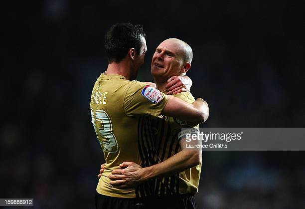 Gary Jones of Bradford City celebrates reaching the final with teammate Rory McArdle at the end of the Capital One Cup SemiFinal Second Leg between...