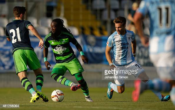 Gary Kagelmacher of 1860 Muenchen battles for the ball with Marvin Emnes and Matt Grimes of Swansea during the preseason friendly match between TSV...