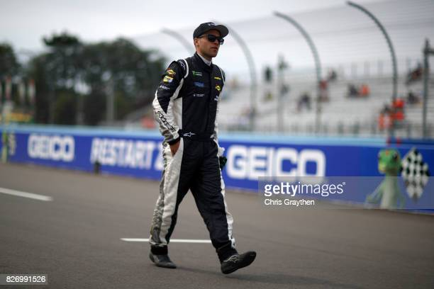 Gary Klutt driver of the Color Compass Corporation Chevrolet stands on the grid during qualifying for the Monster Energy NASCAR Cup Series I Love NY...